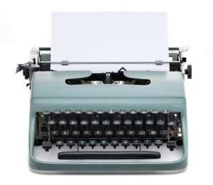 vintage typewriter with blank paper to write text, isolated